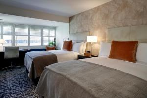 A bed or beds in a room at The Dupont Circle Hotel