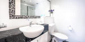 A bathroom at Victoria Square Apartments