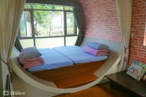 A bed or beds in a room at Mei Nong Villa