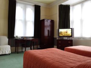 A television and/or entertainment center at Beech House Hotel