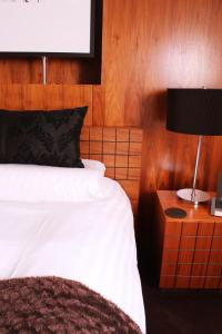 A bed or beds in a room at The Kenilworth