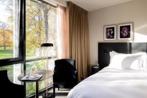 A bed or beds in a room at Pillows Luxury Boutique Hotel Aan De IJssel