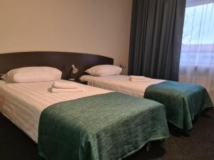 A bed or beds in a room at Inger Hotel