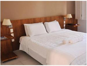 A bed or beds in a room at Engenho da Serra Hotel e EcoResort