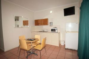 A kitchen or kitchenette at Whitsunday on The Beach