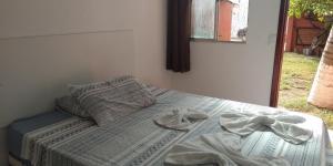 Cama ou camas em um quarto em Pousada Suites das Galinhas