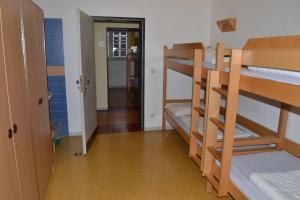 A bunk bed or bunk beds in a room at Jugendherberge Lübeck Altstadt