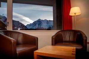 Ein Sitzbereich in der Unterkunft Hotel Gädi