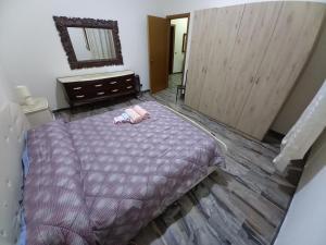 A bed or beds in a room at Bella Reggio