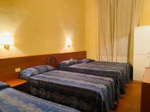 A bed or beds in a room at Hotel Ferrari