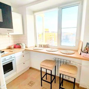 Кухня или мини-кухня в Apartment on Lenina 8