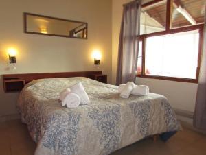 Una cama o camas en una habitación de Las Gaviotas