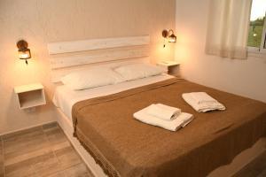 Una cama o camas en una habitación de Cabañas Viento Andino