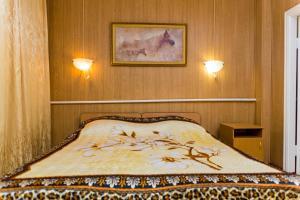 """Кровать или кровати в номере Мотель - Центр отдыха """"Сосновка"""""""
