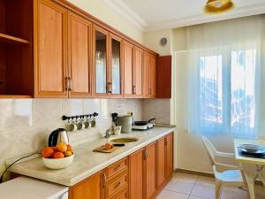 A kitchen or kitchenette at Melissa Garden Apart Hotel