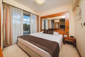 Krevet ili kreveti u jedinici u okviru objekta Hotel Podgorica