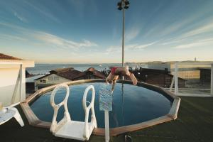 The swimming pool at or close to Sunset Destination Hostel