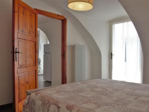 Letto o letti in una camera di Locazione Turistica Ca' Pignoi - GAA262