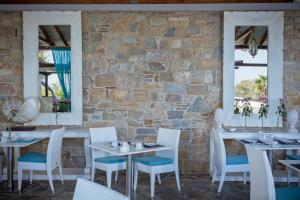A restaurant or other place to eat at Aegean Suites Hotel