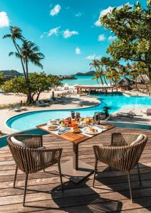 The swimming pool at or near Le Bora Bora by Pearl Resorts