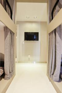 A television and/or entertainment centre at Haru Hostel Guesthouse Sokcho
