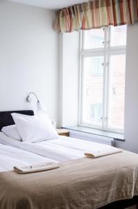 Säng eller sängar i ett rum på Hotel Vanilla