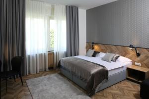 Ein Bett oder Betten in einem Zimmer der Unterkunft Urban Boutique Hotel Center