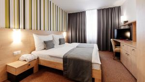 A bed or beds in a room at Hotel Vista