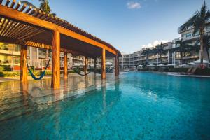 The swimming pool at or near Now Jade Riviera Cancun Resort & Spa - All Inclusive