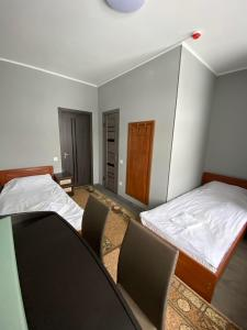 A bed or beds in a room at Maximus hotel