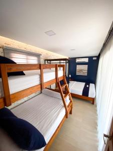 A bunk bed or bunk beds in a room at Crusoe Cabins