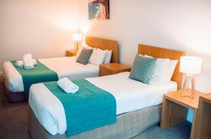 A bed or beds in a room at Great Ocean Road Resort