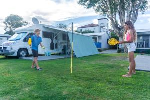 A family staying at Nobby Beach Holiday Village