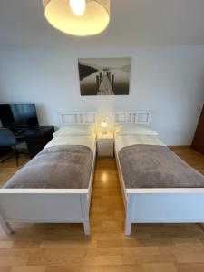 Ein Bett oder Betten in einem Zimmer der Unterkunft Escale