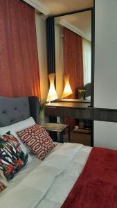 A bed or beds in a room at Апартаменты с отдельным входом