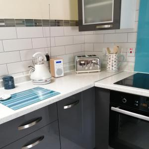 A kitchen or kitchenette at Buttermere Cottage