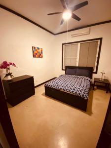 A bed or beds in a room at Emmanuelli Sur 3 Bedroom Home
