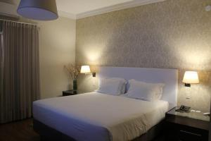 Cama ou camas em um quarto em Hotel Cordialle