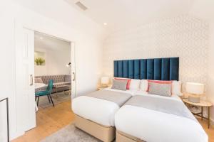 Кровать или кровати в номере Debambú Suites