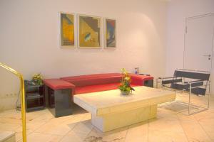 Ein Sitzbereich in der Unterkunft Dom-Hotel