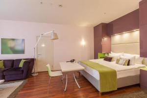A bed or beds in a room at Mamaison All-Suites Spa Hotel Pokrovka