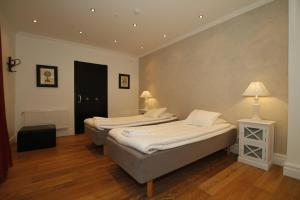 A bed or beds in a room at Donners Hotell, Sure Hotel Collection by Best Western