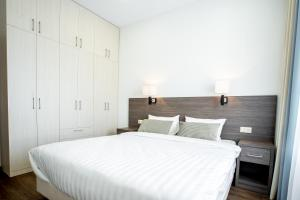 A bed or beds in a room at Ramada Hotel & Suites by Wyndham Novosibirsk Zhukovka
