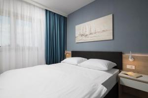 Ein Bett oder Betten in einem Zimmer der Unterkunft Garden Palace Resort