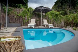 The swimming pool at or near Tranquility B&B