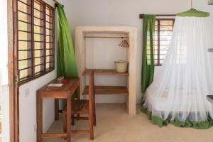 A bunk bed or bunk beds in a room at Red Monkey Beach Lodge