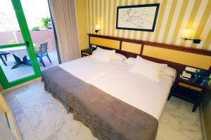 Cama o camas de una habitación en Holiday World RIWO Hotel.