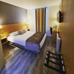 Un ou plusieurs lits dans un hébergement de l'établissement Hotel Les Beaux Soleils