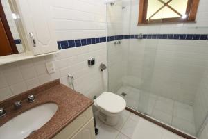 A bathroom at Tarkna - hotel recanto das aguas