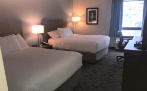 A bed or beds in a room at Travelodge by Wyndham Sydney